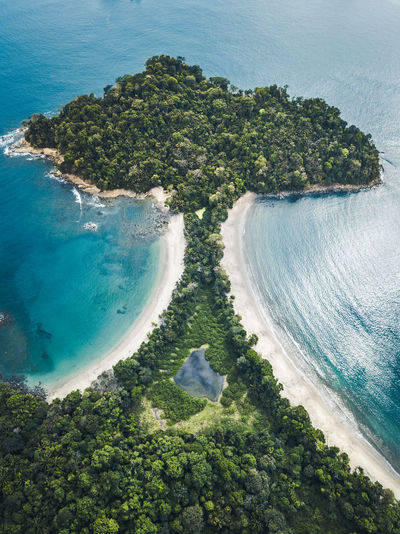 The pristine and beautiful Manuel Antonio playa from above. The beach belongs to a natural park with rain forest being seamed by a narrow stripe of white sand. Costa Rica Beach Aerial Aerial Photography Drone  Drone Photography Manuel Antonio Palm Tree Paradise Rain Forest Waves Pacific National Park Ocean Beach Life Manuel Antonio National Park Travel Travel Destinations Traveling Travel Photography