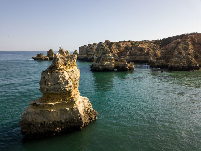 Algarve Backround Clear Sky Day Horizon Over Water No People Outdoors Physical Geography Rock - Object Rock Formation Scenics Sea Tranquil Scene Tranquility Travel Destinations Water Waterfront