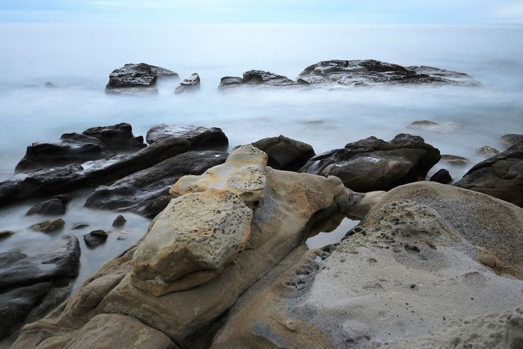 Rock Sea Solid Water Rock - Object Sky Scenics - Nature Beauty In Nature Nature Land No People Beach Tranquility Tranquil Scene Rock Formation Day Motion Horizon Over Water Non-urban Scene