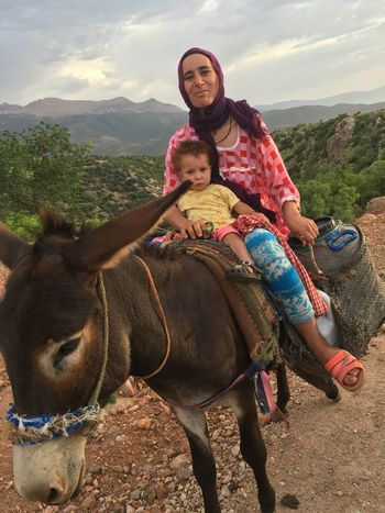 Moroccan Memories Animal Animal Themes Berber  Child Childhood Cold Temperature Day EyeEm Gallery Family Females Full Length Happiness Looking At Camera Mother Mountain Mountain People Nature Nature Outdoors People Portrait Smiling Togetherness Two People Vacations