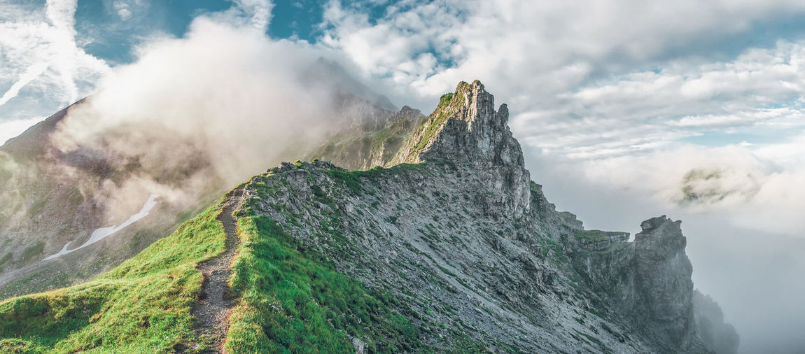 High Angle View Mountain Against Sky During Foggy Weather