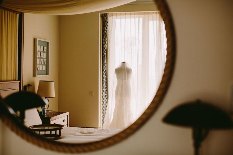 Reflection of wedding dress on mirror