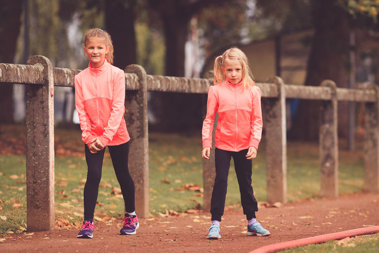 Two girls exercising on running track 2 Girls Running Vitality Assertive Assertiveness Challenge Childhood Competition Discipline Endurance Exercising Friendship Full Length Girls Happiness Leisure Activity Lifestyles Outdoors Perseverance Real People Running Track Sports Clothing Togetherness Training