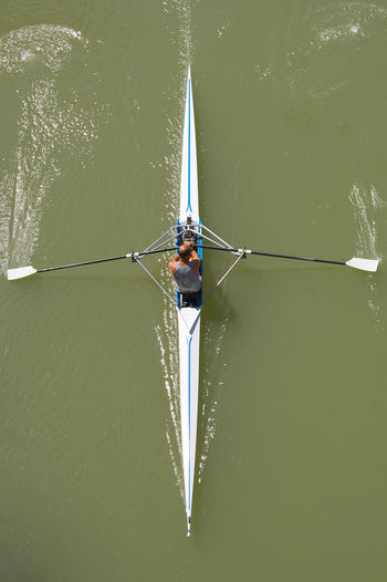 Directly above shot of man rowing boat in river