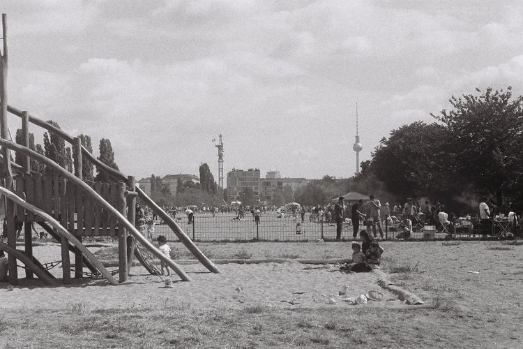 berlin Filmisnotdead Film Photography Film Black And White Blackandwhite Black Outdoors Playground Park - Man Made Space Park City Men Building Exterior Group Of People Real People Clear Sky Land Women