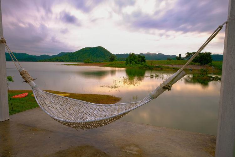 Fishing net in lake against sky