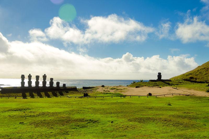 Moai Statues At Beach Against Sky