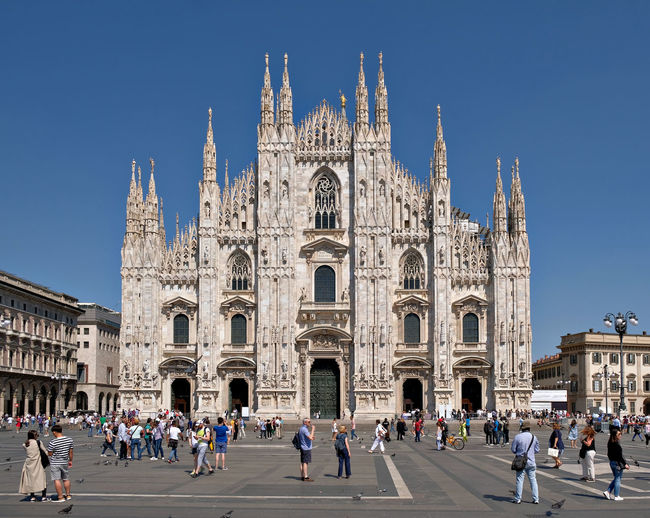 Activity Adult Architecture Building Exterior Built Structure Cathedral Of Milano Clear Sky Day El Duomo Large Group Of People Men Milano Outdoors People Piazza Del Duomo Place Of Worship Real People Religion Sky Spirituality Square Travel Destinations