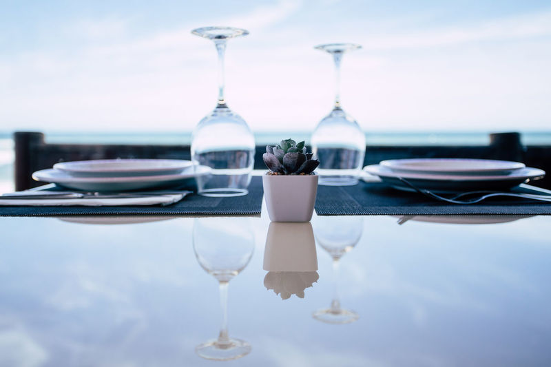 Close-up of drink on table at restaurant against sky