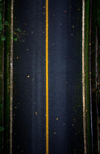 Full frame shot of yellow car on road