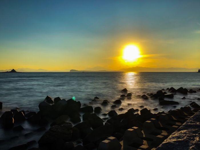 Sea Water Sky Sunset Scenics - Nature Beach Beauty In Nature No People Sun Sunlight Rock Horizon Over Water Horizon Tranquility