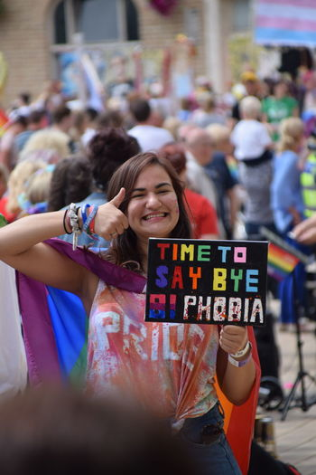 Signs shown during UK Pride parade as part of Hull UK City of Culture 2017 (22nd July 2017) Hull Hull City Of Culture 2017 Pride In Hull UK Pride Adult Celebration Cheerful Crowd Day Excitement Happiness Hull 2017 Leisure Activity Lgbt Lgbt Pride Lifestyles Multi Colored One Person Outdoors People Portrait Pride Parade Real People Smiling Text