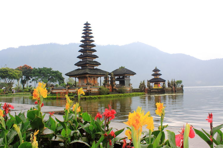 Pura Ulan Danu Bratan temple in Bali, Indonesia Bali Bali Indonesia Pura Ulun Danu Bratan Temple Travel Traveling Danau Bratan Bali Mountain Place Of Worship Plant Religion Spirituality Travel Destinations