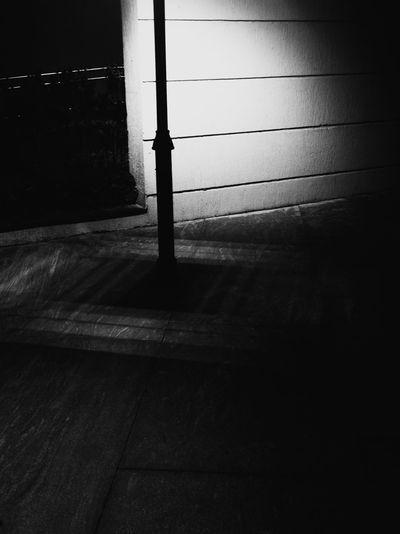 Shadow of railing on wall