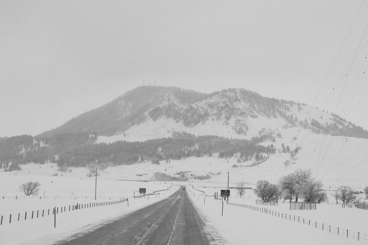 Eyemmarket EyeEm Gallery Fresh On Eyeem  Transportation Travel EyeEmBestPics Snow Winter Wildwildwest Outdoors Nature Forest Scenics Mountain View Mountain Road Beauty In Nature Eye4photography  America Snow Covered Blackandwhitephotography Black&white Black And White Openroad