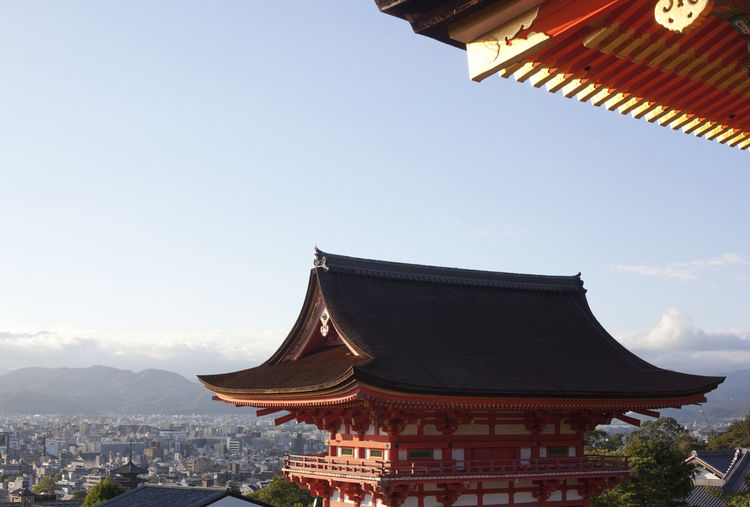 Low angle view of pagoda against sky in city