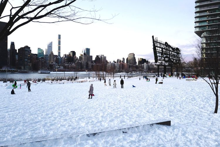 Gantry Plaza State Park, Feb. 2017 Longislandcity LIC NYC Queens Large Group Of People Outdoors Snow Winter Urban Skyline Cityscape Urban Landscape Skyline Winter Streetphoto_color Leicaq Playing In The Snow Playing In The Park Shades Of Winter