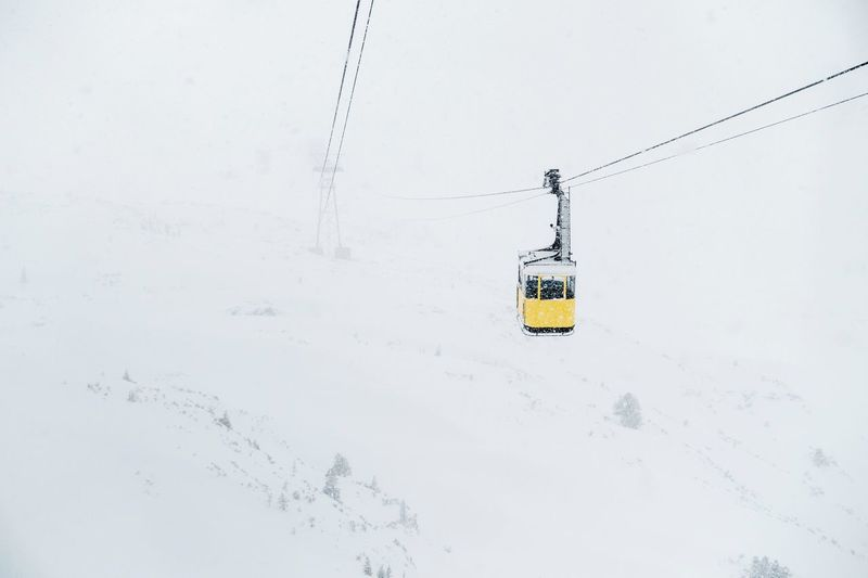 Up! Mountain Snow Winter EyeEm Selects Winter Transportation Snow Cold Temperature Cable Car Nature Mode Of Transportation Cable White Color Outdoors Sky Land Overhead Cable Car No People Ski Lift Travel Hanging High Angle View Day