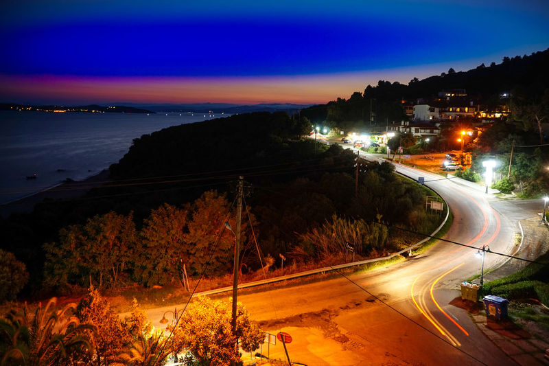 GREECE ♥♥ HUAWEI Photo Award: After Dark Blurred Motion High Angle View Illuminated Light Trail Long Exposure Motion Nature Night No People Ouranoupolis Outdoors Plant Road Sky Speed Street