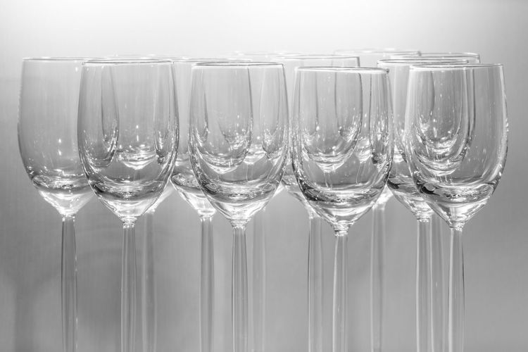 Empty wineglasses against white background