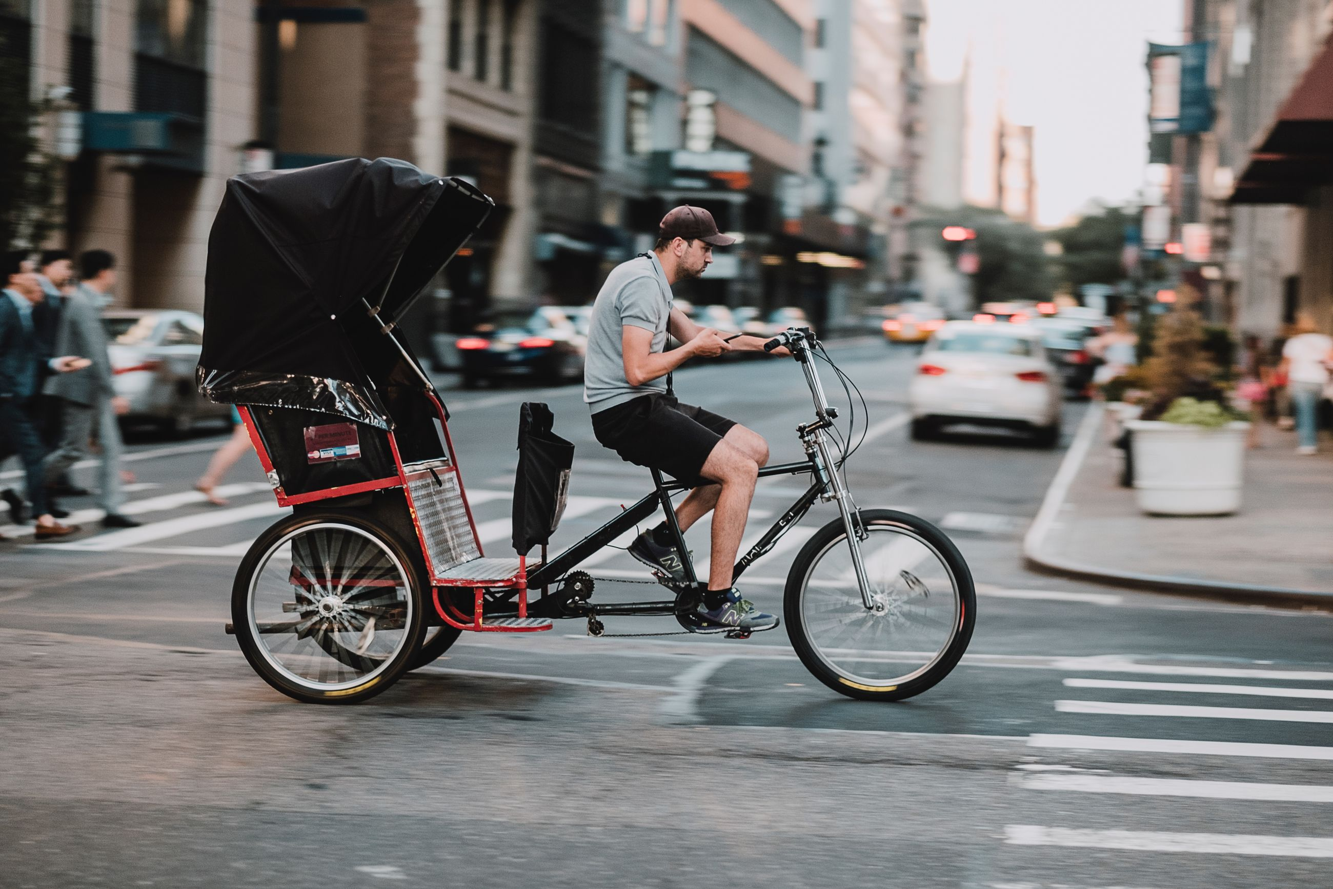 city, transportation, street, bicycle, mode of transportation, real people, architecture, full length, building exterior, land vehicle, lifestyles, one person, riding, ride, city street, city life, incidental people, focus on foreground, men, road, outdoors