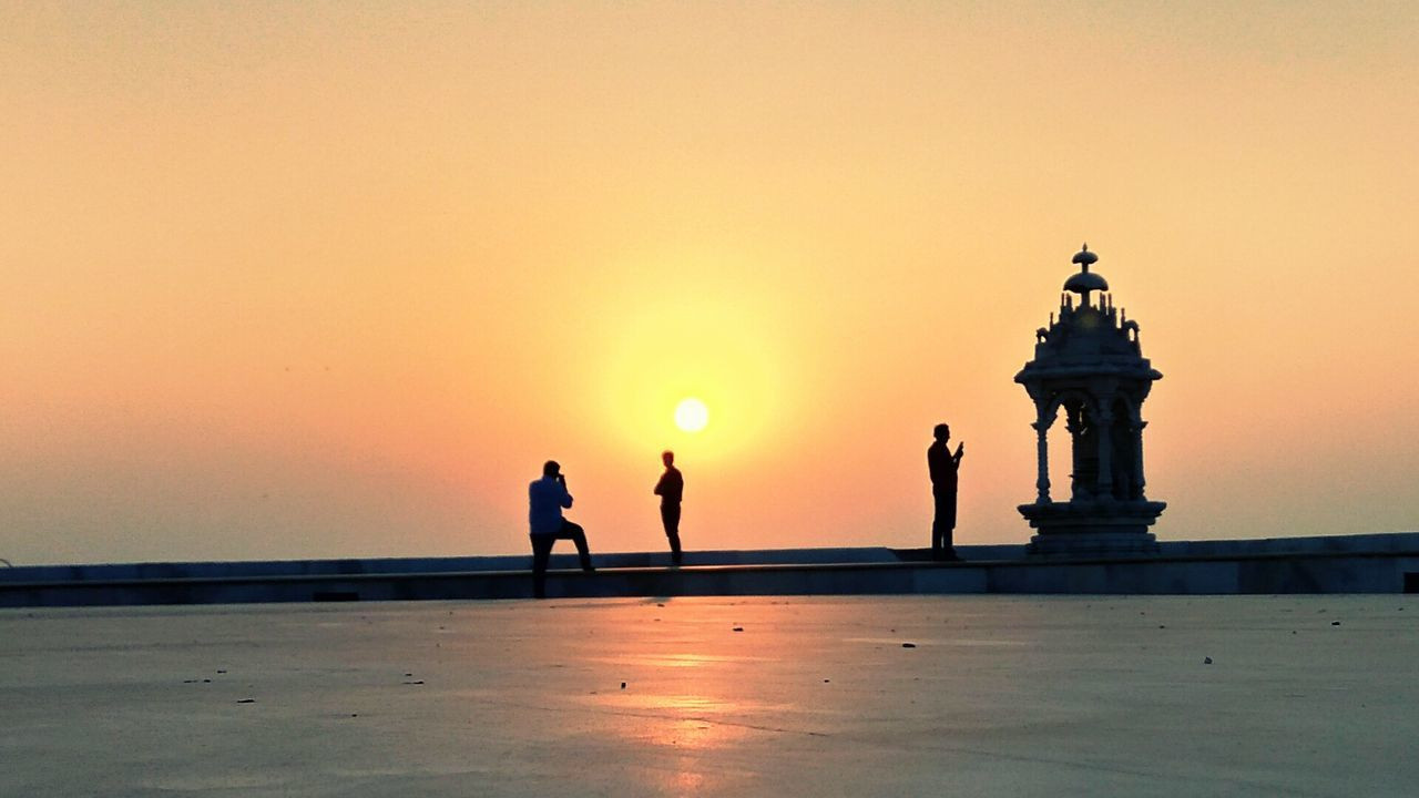sunset, copy space, sun, sky, sea, clear sky, nature, outdoors, travel destinations, silhouette, tourism, architecture, travel, beauty in nature, real people, built structure, water, men, building exterior, day, people