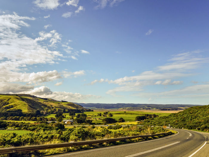 Country Road Through Scenic Landscape