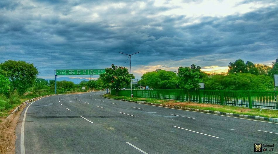 Early mornings, sunrise, rainy season and empty roads... Cloud - Sky Tree Road Outdoors No People Day Transportation Sky Nature Highwayphotography Bikes Dramatic Sky Freshness Highway Plant Cityscape Photography Cycletour Explorer Travelgram Calm Sunrise_Collection Sunrise Silhouette Cloudscape
