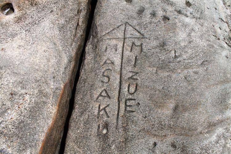 Inscribed Incised Lettered Masaki Mizue Grafitti Name Couple Japanese Tradition Ai Ai Gasa Close-up Detail Grey Japan Love Rocks Seashore Textured  Written Handwriting