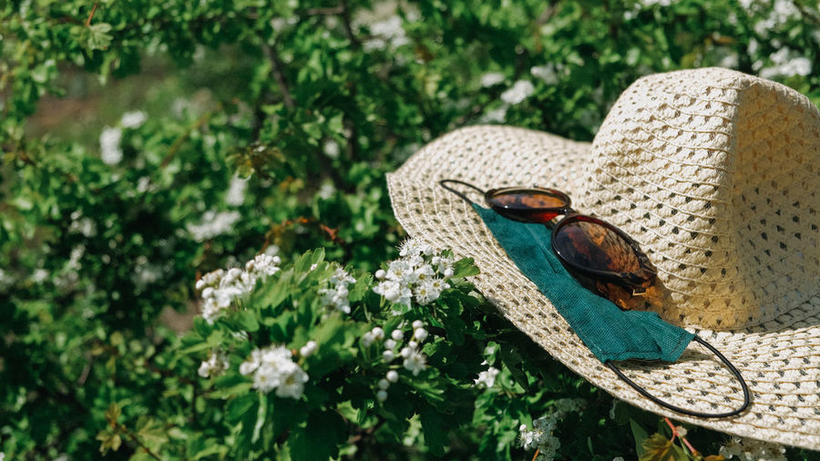 Staycations, hyper-local travel, family outing, new normal concept. straw hat, sunglasses