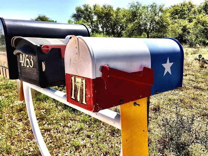 Red Grass Field Mailbox Outdoors Metal Nature Communication Day No People Tree Sky Roadside America Texas Landscape Texasproud