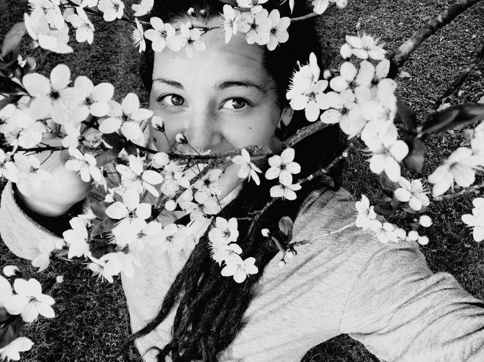 Portrait of person on flowering plant