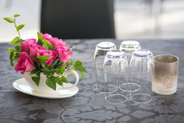 Close-up of pink roses in vase on table