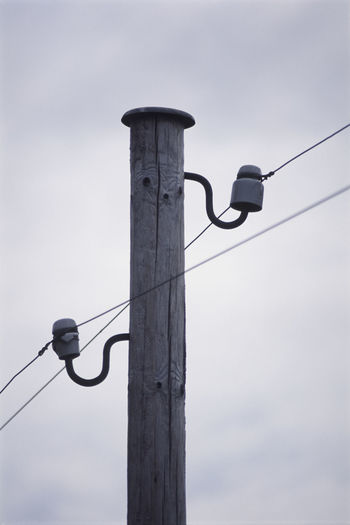 old telegraph line with ceramic insulators Ceramic Electric Electricity  Glazed Insulators Isolators LINE Link Metal Phonecommunication Phoneline Pole Pot Power Line  Telegraph Telegraphtelphone Telegraphy White Wires Wooden