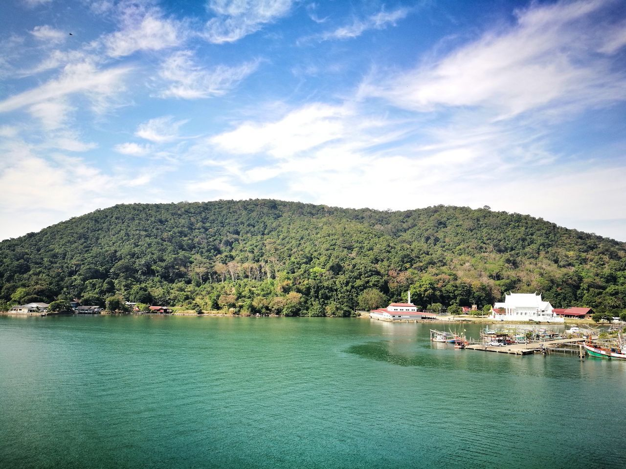 water, sky, tree, scenics, beauty in nature, nature, nautical vessel, mountain, tranquility, tranquil scene, waterfront, cloud - sky, day, outdoors, lake, no people, moored, architecture