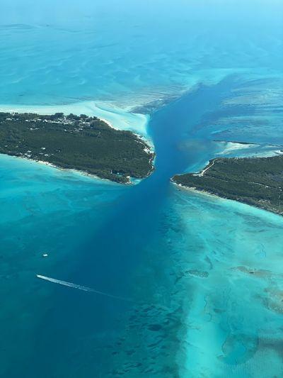 Aerial view of sea against blue sky