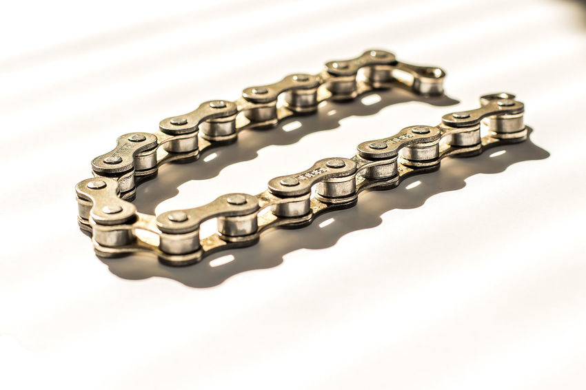 hi key studio shot, of bicycle chain Chain Close-up Coin Day Finance Gold Gold Colored Hi Key Howard Roberts Light And Shadow Metal Missing Link No People Norristown Studio Studio Photography Studio Shot Wealth White White Background