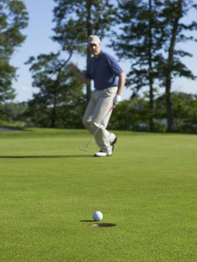 Full length of man playing golf