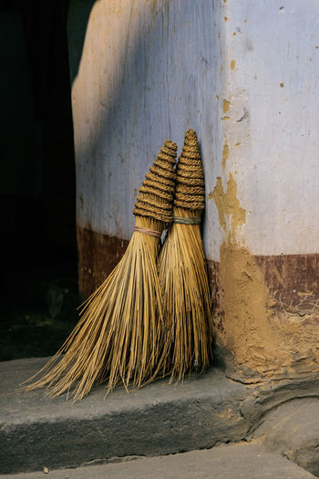 Close-Up Of Brooms At House