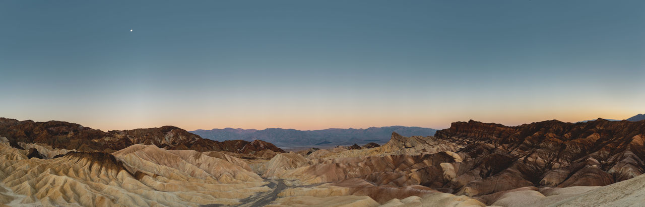 Before sunrise shot of the eroded landscape at Zabriskie Point, Death Valley, California, USA. Zabriskie Point Death Valley Death Valley National Park Amargosa Range Eroded Landscape Desert Vastness Eroded Rocks Moon Panorama High Resolution Sediments Iconic Iconic Landmark Iconic Landscape Texture Soft Colors  Sky Travel Travel Destinations Rock Formation Scenics Discover The World Places Around The World