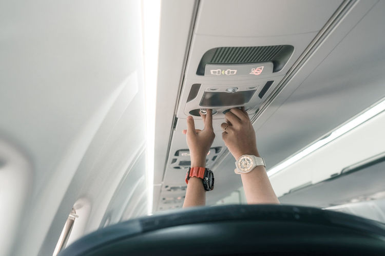 Midsection of man in airplane