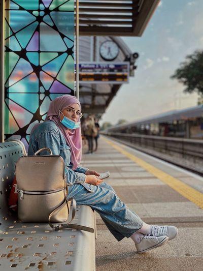 Man sitting at railroad station