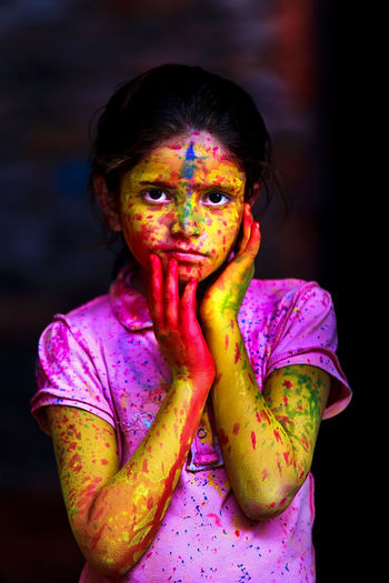 Portrait of girl with powder paint during holi
