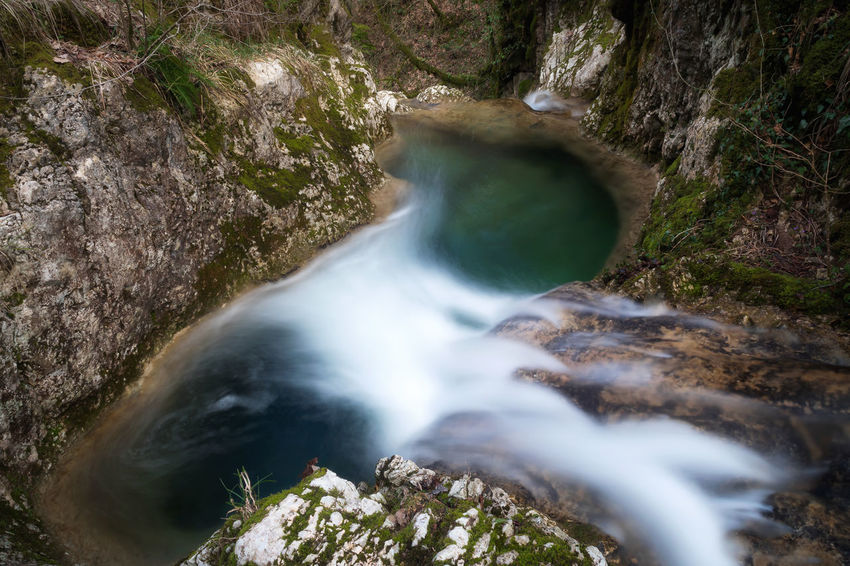 Pozza del Diavolo waterfall, in the municipality of Monte San Giovanni in Sabina, Italy. Waterfall, long exposure. Flowing Water Green Color Nature Tranquility Blurred Motion Green Colors Idyllic Scenery Outdoors Power In Nature Pozza Del Diavolo River Tranquilly Scene Water Waterfall