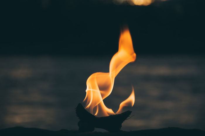 Fire Flame Burning Close-up Concepts Lit Vibrant Color Orange Color Heat Coconut Burning Water River