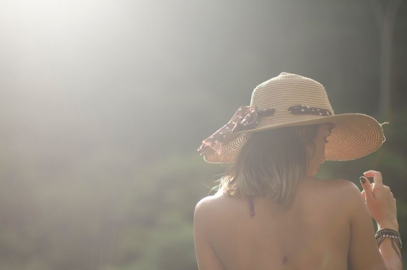 Rear View Of Woman Wearing Hat During Sunny Day