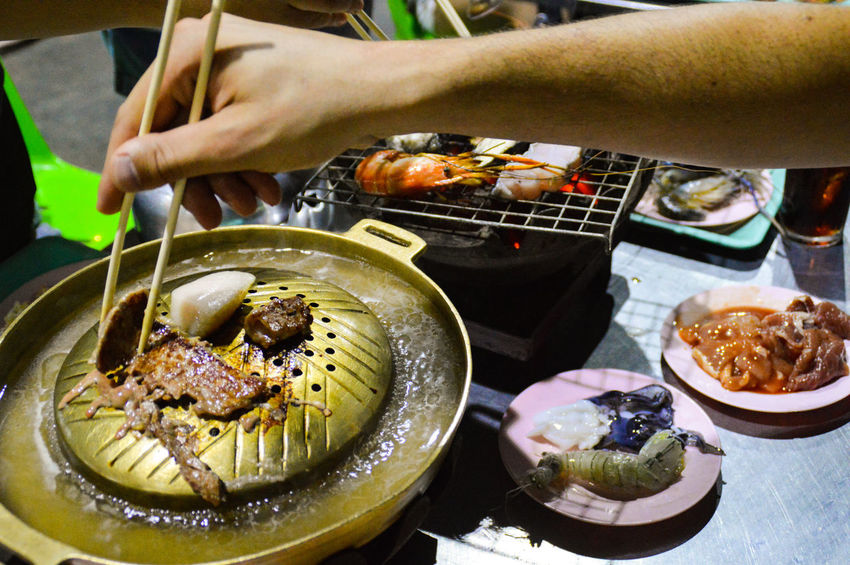 Human Hand Using Chopsticks Food And Drink Real People Freshness Grilled Meat Hot Pot Night Ready-to-eat Food Plate Close-up Night Life Bangkok, Thailand Travel Travel Photography Night Market In Thailand