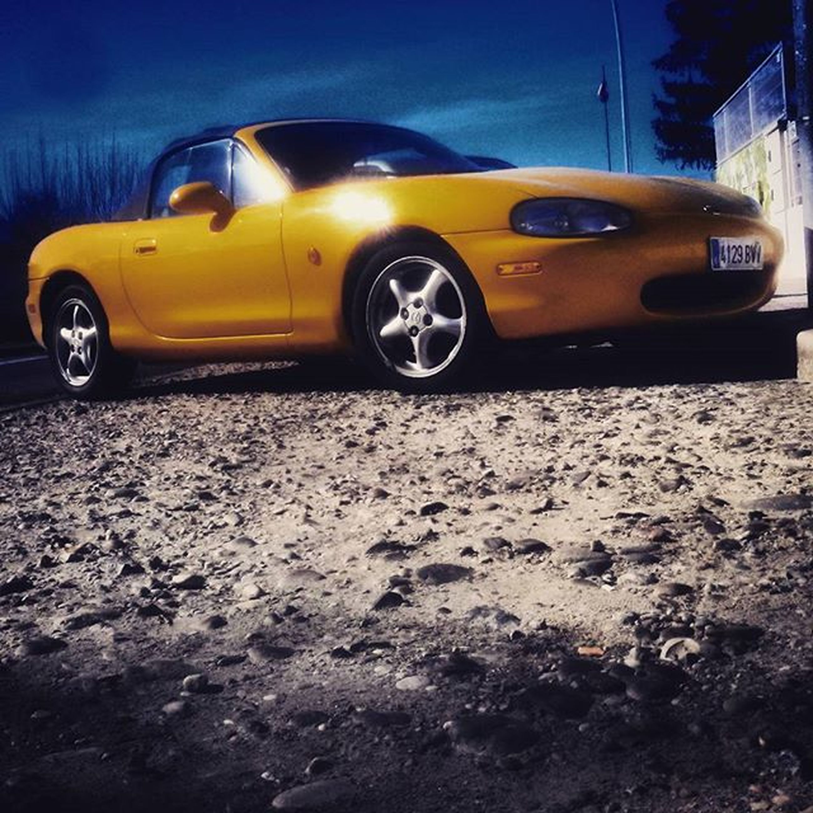 transportation, land vehicle, mode of transport, car, street, yellow, stationary, road, headlight, travel, outdoors, no people, parked, parking, on the move, vehicle, sunlight, day, surface level, close-up