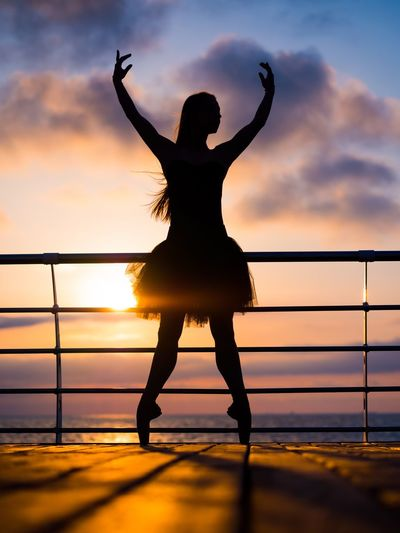 Sunset Silhouette Sky Water One Person Nature Full Length Real People Skill  Sea Outdoors Lifestyles Beauty In Nature Women Day People Ballet Dancer Tutu Ballerina Stretching