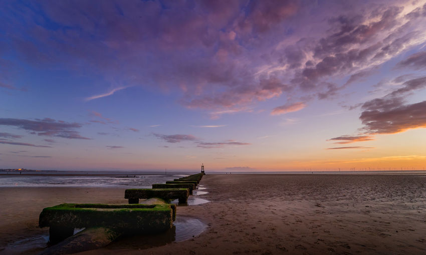 Pier visible at low tide on Crosby Beach, Waterloo. Blue Hour Crosby Beach Liverpool, England Waterloo Beach Beauty In Nature Cloud - Sky Day Horizon Over Water Nature No People Outdoors Scenics Sea Sky Summer Sunset Tranquil Scene Tranquility Water